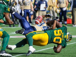 Eskimos' Almondo Sewell knocks the ball loose from Bombers' Paris Cotton during a game in 2014. Sewell, 34, joined the Alouettes as a free agent on Tuesday.