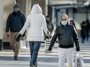 Shoppers in downtown Toronto on February 3, 2021. Health officials are warning Canadians of the potential for increased contagiousness of the COVID variants.