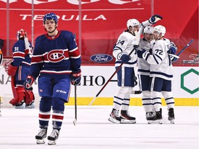 Toronto Maple Leafs players celebrate after second-period goal by Mitch Marner on Canadiens goalie Carey Price Saturday night at the Bell Centre in Montreal.