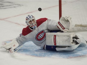Canadiens goalie Jake Allen makes a save on a shot from Senators' Brady Tkatchuk in overtime at the Canadian Tire Centre in Ottawa on Sunday, Feb. 21, 2021.