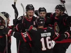 The Senators' Brady Tkachuk celebrates with teammates after scoring in overtime for 3-2 win over the Canadiens Sunday night in Ottawa.
