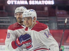 Canadiens' Nick Suzuki (14) celebrates with defenceman Jeff Petry his goal scored in the first period against the Senators at the Canadian Tire Centre in Ottawa on Sunday, Feb. 21, 2021.