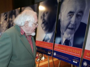 Montreal-born singer, composer and playwright Raymond Lévesque walks by his portrait in 2005 at the Governor General's Performing Arts Awards. The ardent separatist refused the award for political reasons.