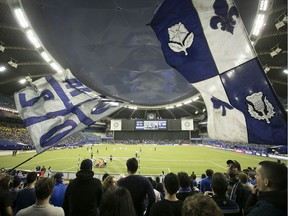 Montreal Impact fans cheer on during the opening minutes of the first half of the CONCACAF Champions League match against the Deportivo Saprissa, in Montreal on Wednesday February 26, 2020.