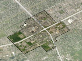 """An aerial view of Pointe-Claire's city centre. Some citizens are lobbying to preserve a forest (left of centre), located just west of the Fairview Pointe-Claire shopping centre along Highway 40. The city's planning program states that much of the Fairview forest is tagged as a """"natural habit mosaic"""" that includes wetlands on the western side."""