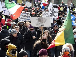 Marchers protest against government health orders to wear masks and social distance in Montreal on Saturday, March 13, 2021.