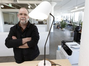 Samuel Lambert, founder of Montreal lighting design company Lambert & Fils, checks out one of his products, made on site, in Montreal, on Thursday, March 25, 2021.