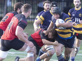 """Town of Mount Royal RFC (in blue) takes on Club de Rugby de Québec in 2019. """"The outdoor transmission risk even during tackles is probably lower than we first thought,"""" said the lead researcher in a study of COVID-19 infections among rugby players."""