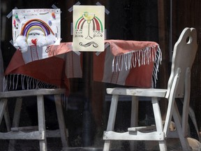 Rainbow drawings are taped to the window of El Sabor de Mexico, on Wellington St. in Montreal.