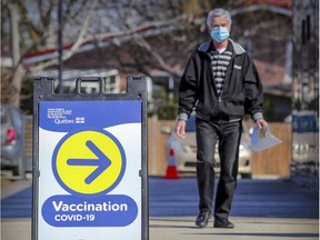 A man heads to the COVID-19 vaccination centre at the Gerry-Roberson Community Centre in Pierrefonds on March 25.