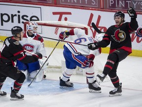 Ottawa Senators left-wing Brady Tkachuk, left, races to congratulate teammate Josh Norris as he celebrates his goal while Montreal Canadiens goaltender Jake Allen and defenceman Shea Weber look on during third period on Feb. 21, 2021, in Ottawa.