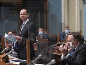 Quebec Finance Minister Eric Girard presents his budget in the legislature in Quebec City on Thursday, March 25, 2021.