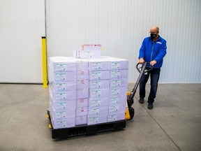 Michael Gray moves some of the 2-million AstraZeneca coronavirus vaccine that Canada has secured at a facility in Milton, Ontario, Canada March 3, 2021.
