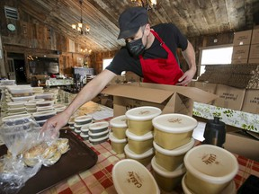 Simon Bernard puts together a meal-in-a-box at his La P'tite Cabane d'la Côte sugar shack in Mirabel, north of Montreal Tuesday February 23, 2021.