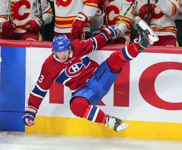 Tyler Toffoli is knocked in the air by a check from Noah Hanifin during third period at the Bell Centre in Montreal on Wednesday, April 14, 2021.