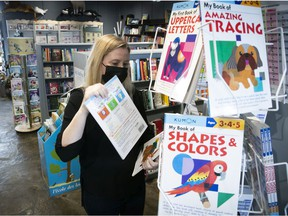 Sylvie Calder arranges a display at the Librairie Clio bookstore located in the Pointe-Claire Plaza.