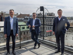 Mayoral candidate Denis Coderre (centre) with Ensemble Montréal team members Serge Sasseville, left, and Guillaume Lavoie.