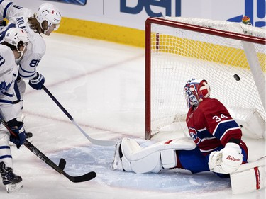 Toronto Maple Leafs centre William Nylander scores a power-play goal on Montreal Canadiens' goaltender Jake Allen during first-period action in Montreal on Wednesday, April 28, 2021.