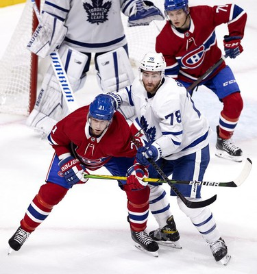 Habs centre Eric Staal is in the thick of it with Toronto Maple Leafs defenseman T.J. Brodie as Habs centre Jake Evans looks on during third-period action in Montreal on Wednesday, April 28, 2021.