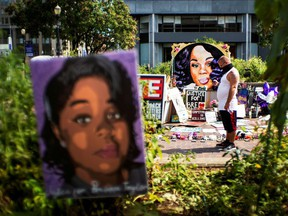A man pauses at the memorial of Breonna Taylor before a march, after a grand jury decided not to bring homicide charges against police officers involved in the fatal shooting of Taylor in her apartment, in Louisville, Kentucky, September 25, 2020.