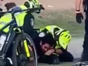 The Montreal police department says it's examining a video that circulated on social media on Sunday showing an officer holding a bearded man in a headlock on the ground and punching him next to Jeanne-Mance Park on Parc Ave.