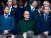 Prince Harry, Prince Philip and Prince William stand for the national anthems at to the 2015 Rugby World Cup Final match between New Zealand and Australia at Twickenham Stadium on Oct. 31, 2015 in London.