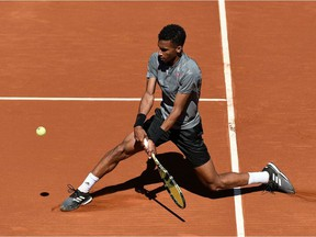 Montreal's Félix Auger Aliassime returns the ball to Greece's Stefanos Tsitsipas during their ATP Barcelona Open tennis tournament singles quarter-final match at the Real Club de Tenis in Barcelona on April 23, 2021.