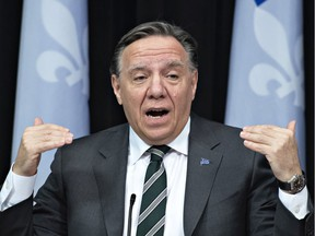 Quebec Premier François Legault responds to reporters' questions during a news conference on the COVID-19 pandemic, Wednesday, March 31, 2021 at the legislature in Quebec City.