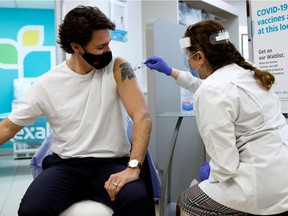 Canada's Prime Minister Justin Trudeau is inoculated with AstraZeneca's vaccine against coronavirus disease (COVID-19) at a pharmacy in Ottawa, Ontario, Canada April 23, 2021.