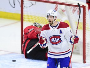 Montreal Canadiens' Paul Byron celebrates a short-handed goal on Ottawa Senators goalie Filip Gustavsson during second period in Ottawa on April 1, 2021.