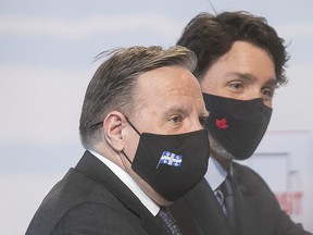 """Premier François Legault and Prime Minister Justin Trudeau after an March: """"If the federal safeguards of Constitution, Charter and Official Languages Act are meaningless as a bulwark in equity, as the declaration of the prime minister appears to imply, where do we turn for a basic understanding and defence of our cause?"""" Clifford Lincoln asks."""