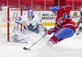 Tyler Toffoli cuts to the net of Toronto Maple Leafs goalie Jack Campbell during first-period action in Montreal on Monday May 3, 2021.