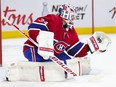 Montreal Canadiens' Jake Allen makes a trapper save during second period against the Toronto Maple Leafs in Montreal on May 3, 2021.