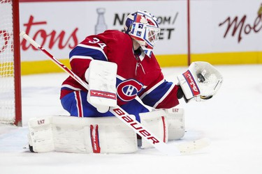 Jake Allen makes a trapper save during second-period action in Montreal on Monday May 3, 2021.