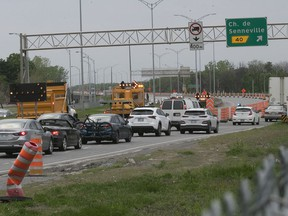 MTQ trucks divert cars away from the Île-aux-Tourtes bridge onto Senneville Rd. on Thursday May 20, 2021, after the bridge was closed for emergency repairs.