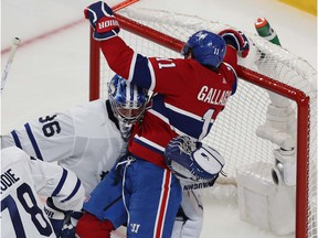 Canadiens' Brendan Gallagher (11) is manhandled away from the net by Toronto Maple Leafs goaltender Jack Campbell during second period action in Game 6 of the first round NHL playoff series in Montreal on Saturday, May 29, 2021.