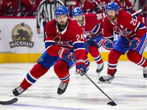 Montreal Canadiens Phillip Danault carries the puck across the Winnipeg Jets blueline trailed by team-mates Jeff Petry, right, and Tomas Tatar during first period of National Hockey League game in Montreal Thursday April 8, 2021.