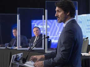 Prime Minister Justin Trudeau speaks as Premier François Legault looks on as they make an announcement March 22, 2021 in Trois-Rivières. Robert Libman says Trudeau has taken the bait in a trap his father would have seen from a mile away.