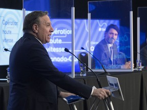 Premier François Legault makes an announcement on high speed internet as Prime Minister Justin Trudeau, right, looks on, Monday, March 22, 2021 in Trois-Rivières.