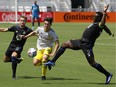 Columbus Crew SC infielder Isaiah Parente (16) and CF Montreal midfielder Djordje Mihailovic  (8) and midfielder Victor Wanyama  (2) battle for the ball during the first half at DRV PNK Stadium in Fort Lauderdale, Fla., on May 1, 2021.
