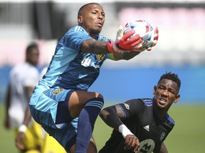 Columbus Crew SC goalkeeper Eloy Room (1) controls the ball against CF Montreal during the first half at DRV PNK Stadium in Fort Lauderdale, Fla., on May 1, 2021.