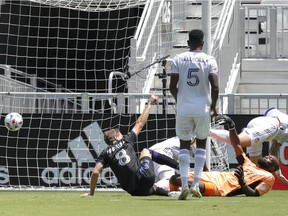 CF Montréal midfielder Djordje Mihailovic (8) reacts after scoring against the FC Cincinnati during the second half at DRV PNK Stadium in Fort Lauderdale, Fla., on May 22, 2021.