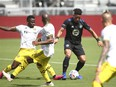 CF Montréal forward Erik Hurtado controls the ball around Columbus Crew SC defender Aboubacar Keita during the first half in Fort Lauderdale, Fla., May 1, 2021.