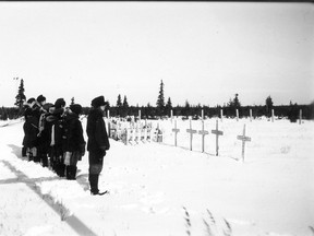 Residential school students at Fort George cemetery, near James Bay, in November 1946. Quebec high school students learn far too little about residential schools and Indigenous perspectives are not voiced, Julia Kaplan says.