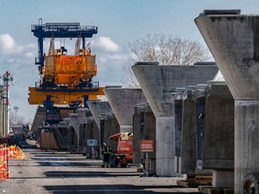 Construction of the REM at Highway 40 in Dollard-des-Ormeaux continues on Thursday March 25, 2021.