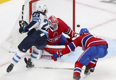 Defenceman  Ben Chiarot deflects shot by Winnipeg Jets Mason Appleton over goalie Carey Price during second period in Montreal Monday, June 7, 2021.