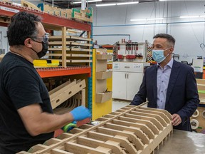 Mario Sévigny, co-founder and executive vice-president of Groupe MSB, chats with assembler Michael Miranda, left, in the company's Boucherville plant on Monday. The Bombardier supplier is expanding its production to bet on a recovery of the business aviation market.