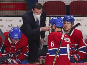 Luke Richardson gives instructions to Canadiens captain Shea Weber during Game 3 of Stanley Cup semifinal series against the Vegas Golden Knights at the Bell Centre during his debut as an NHL head coach.