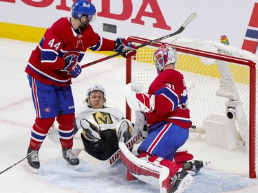 Canadiens' defenceman Joel Edmundson checks Vegas Golden Knights' William Karlsson next to goalie Carey Price during the first period of the National Hockey League playoff game in Montreal on Friday, June 18, 2021.