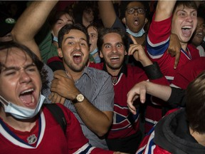 Fans celebrate outside the Bell Centre after the Canadiens beat the Vegas Golden Knights 3-2 in overtime Friday night in Game 3 of their Stanley Cup semifinal series. The Canadiens lead the series 2-1.
